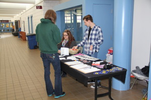 DMACC United booth informing students and faculty about the Diversity Commission's decision to continue supporting the LGBTQ Alliance Conference