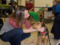 Jordan Starmer, 20, from Des Moines, pets Britt. The ARL brought dogs in to Building 5 Wednesday Dec. 4.