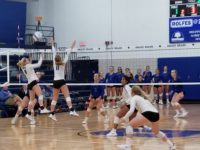 Madison Paulsen and Lacey Clark rise for the block