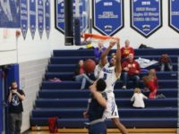 Dyllan Robinson dunks over a Metropolitan defender. Photo courtesy DMACC Athletics.