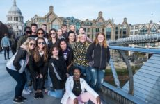 The Spring 2019 study abroad class stands on bridge in London.