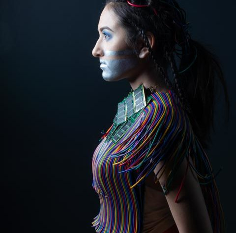 """Lucas Anderson of Davenport designed """"Cyberpunk — Tech- nology to Take Over,"""" modeled by North High School student Lily Inthalangsy."""