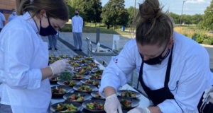 Culinary students make fruit salads at an event outside of Building 7 earlier this semester. Photo courtesy DMACC.