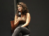 Des Moines Register reporter Andrea Sahouri speaks at DMACC Wednesday, Sept. 15, in the Black Box Theater.